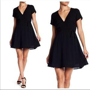 Lush black wrap dress